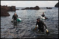 Women divers emerging from water. Jeju Island, South Korea ( color)