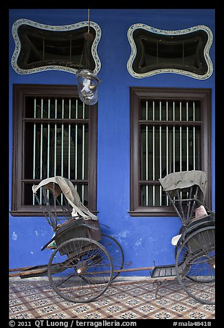 Rickshaws and windows, Cheong Fatt Tze Mansion. George Town, Penang, Malaysia (color)