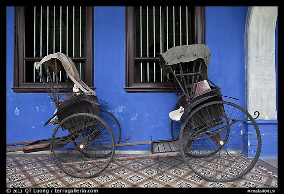 Bicycle rickshaws, Cheong Fatt Tze Mansion. George Town, Penang, Malaysia (color)