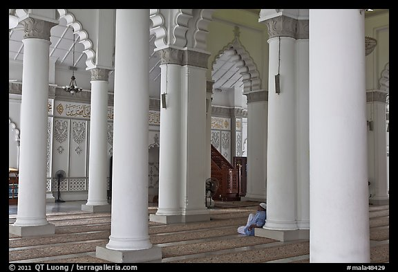 Man in prayer inside Masjid Kapitan Keling mosque. George Town, Penang, Malaysia (color)