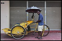 Driver and trishaw. George Town, Penang, Malaysia ( color)