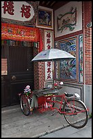 Bicycle rickshaw at temple entrance. George Town, Penang, Malaysia