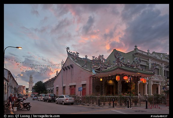 Temple and distant minaret at sunset. George Town, Penang, Malaysia (color)