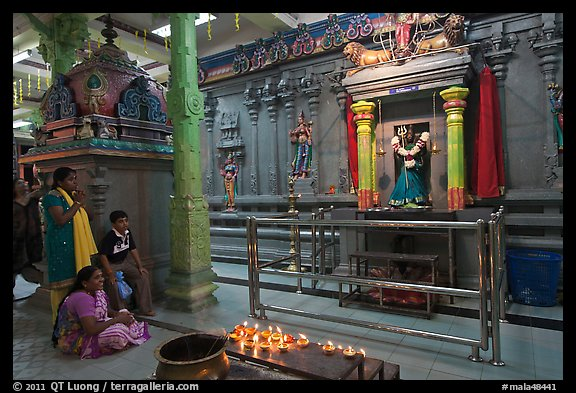Family in prayer, Sri Mariamman Temple. George Town, Penang, Malaysia (color)