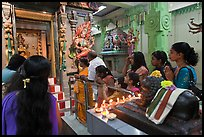 Devotees inside Tamil Nadu temple. George Town, Penang, Malaysia (color)