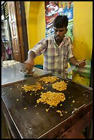 Man preparing indian food. George Town, Penang, Malaysia (color)