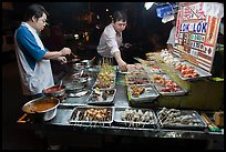 Men arranging skewers on hawker stall. George Town, Penang, Malaysia ( color)