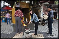 Worshiping at Buddhist street altar. George Town, Penang, Malaysia ( color)