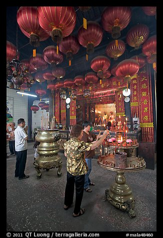 Worshiping inside goddess of Mercy temple. George Town, Penang, Malaysia (color)