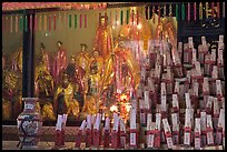 Statues and sticks, Kuan Yin Teng temple. George Town, Penang, Malaysia (color)