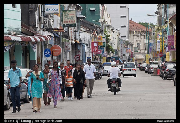 Malay people walking on street. George Town, Penang, Malaysia (color)