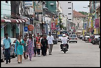 Malay people walking on street. George Town, Penang, Malaysia ( color)