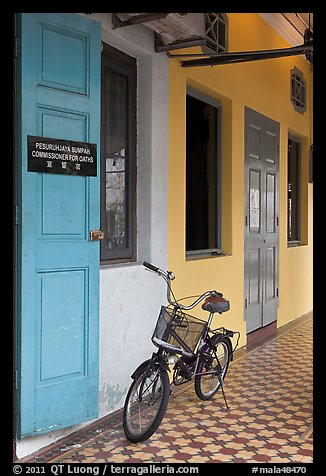 Bicycle in front of office. George Town, Penang, Malaysia (color)