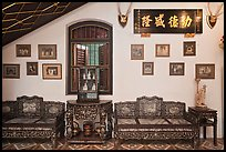 Antique furniture and images, Pinang Peranakan Mansion. George Town, Penang, Malaysia (color)