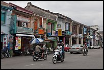 Chinatown street with traffic and storehouses. George Town, Penang, Malaysia (color)