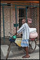 Malay with loaded bicycle. George Town, Penang, Malaysia (color)