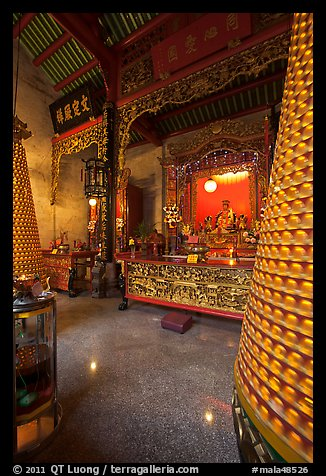 Altar and wheels in motion, Hainan Temple. George Town, Penang, Malaysia (color)