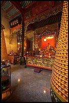 Altar and wheels in motion, Hainan Temple. George Town, Penang, Malaysia ( color)