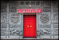 Red door and slate carved wall, Hainan Temple. George Town, Penang, Malaysia (color)