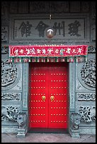 Crimson door and slate wall, Hainan Temple. George Town, Penang, Malaysia (color)