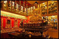 Buddha image inside Yellow Hat Buddhist temple. George Town, Penang, Malaysia (color)
