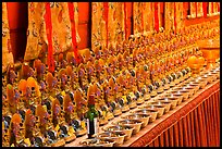 Rows of Jambhala figures, Gelugpa Buddhist Association temple. George Town, Penang, Malaysia (color)
