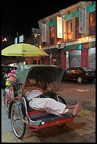 Driver taking nap in trishaw at night. George Town, Penang, Malaysia ( color)