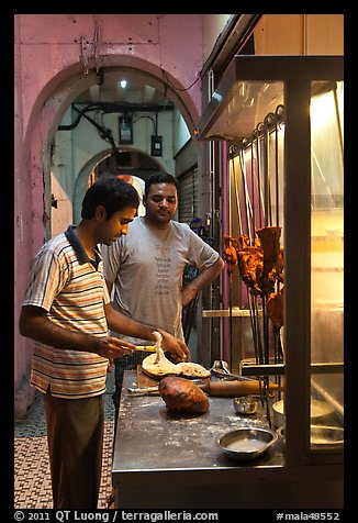 Man preparing nan bread in arcade. George Town, Penang, Malaysia (color)