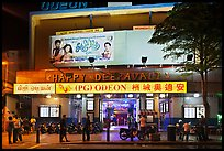 Movie theater showing Bollywood films at night. George Town, Penang, Malaysia ( color)