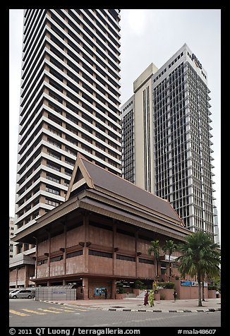 Wooden traditional building at the base of high-rises. Kuala Lumpur, Malaysia (color)