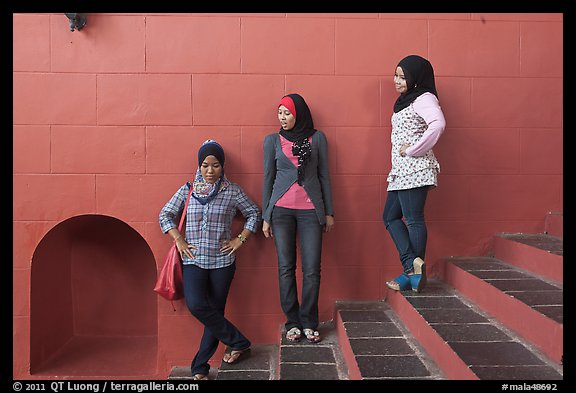 Young women with islamic headscarfs and modern fashions. Malacca City, Malaysia (color)