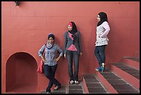Young women with islamic headscarfs and modern fashions. Malacca City, Malaysia
