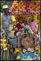 Decorated trishaw driver and passengers. Malacca City, Malaysia