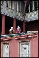 Women sitting, Stadthuys. Malacca City, Malaysia (color)