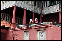 Stadthuys detail with two women. Malacca City, Malaysia
