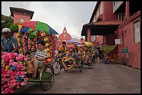 Trishaws leaving Town Square and Stadthuys. Malacca City, Malaysia
