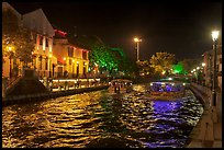 Tour boats on Melaka River at night. Malacca City, Malaysia (color)