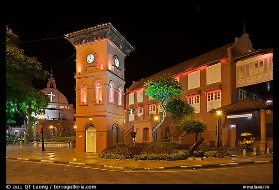 Town Square with Stadthuys, clock tower, and church at night. Malacca City, Malaysia (color)
