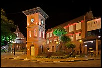 Town Square with Stadthuys, clock tower, and church at night. Malacca City, Malaysia