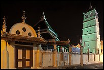 Gate, Mosque, and minaret, Masjid Kampung Hulu at night. Malacca City, Malaysia