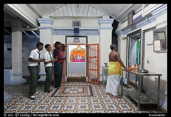 Worhipers and holy man, Sri Poyyatha Vinayagar Moorthi Temple. Malacca City, Malaysia
