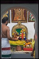 Holy men lighting fire, Sri Poyyatha Vinayagar Moorthi Temple. Malacca City, Malaysia (color)