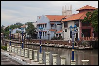 Lamps, riverside houses and St Peters Church towers. Malacca City, Malaysia (color)