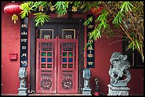 Chinese house entrance with lion sculpture and lanterns. Malacca City, Malaysia ( color)