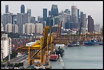 Cranes in harbor and CBD skyscrappers. Singapore (color)