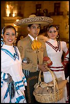 Man with sombrero hat surrounded by  two women. Guadalajara, Jalisco, Mexico ( color)