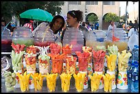 Cups of fresh fruits offered for sale on the street. Guadalajara, Jalisco, Mexico (color)