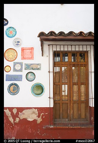 Wall decorated with colorful ceramic pieces, Tlaquepaque. Jalisco, Mexico (color)