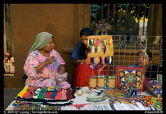 Huichol women selling crafts on the street, Tlaquepaque. Jalisco, Mexico (color)