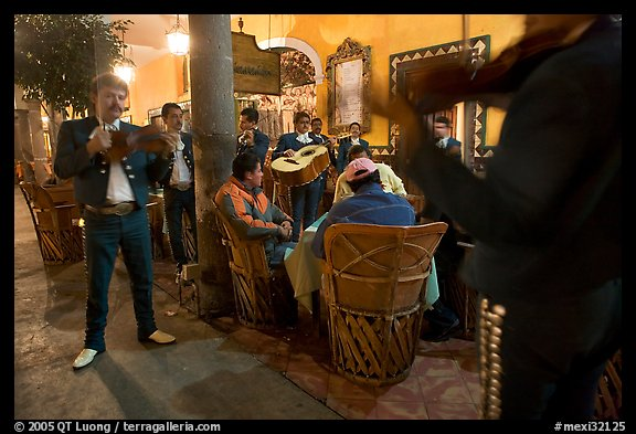 Mariachi musicians performing a serenade at the Parian, Tlaquepaque. Jalisco, Mexico (color)
